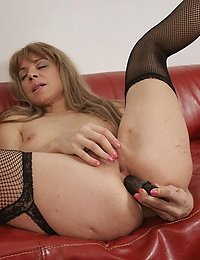 Naughty housewife playing with herself on the couch