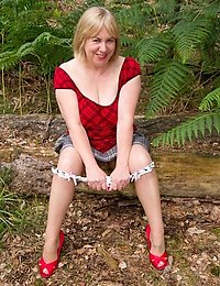 Hi Guys one of my TAC Site Members had asked if I could do a raunchy UpSkirt Pic Set so as Im always willing to please we headed off to the woods and